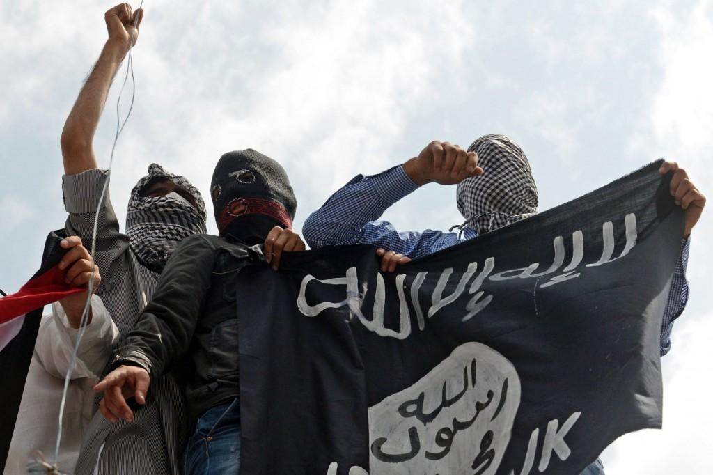 الإرهاب بين الأعلام الحُمر .. والرايات السود