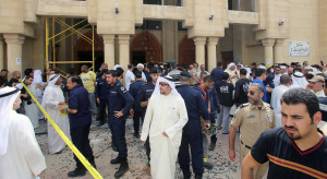 Kuwaiti security forces gather outside the Shiite Al-Imam al-Sadeq mosque after it was targeted by a suicide bombing during Friday prayers on June 26, 2015, in Kuwait City. The Islamic State group-affiliated group in Saudi Arabia, calling itself Najd Province, said militant Abu Suleiman al-Muwahhid carried out the attack, which it claimed was spreading Shiite teachings among Sunni Muslims. AFP PHOTO / YASSER AL-ZAYYAT        (Photo credit should read YASSER AL-ZAYYAT/AFP/Getty Images)