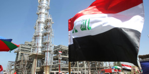 The Iraqi flag flutters during the official opening of the second refinery for crude oil in Al-Dora refinery complex in Baghdad on September 16, 2010. The refinery will produce 70,000 barrels per day of white oil, gas, diesel and liquid gas. AFP PHOTO/ AHMAD AL-RUBAYE (Photo credit should read AHMAD AL-RUBAYE/AFP/Getty Images)