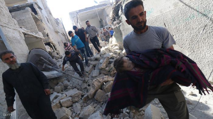 A Syrian man carries the body of a baby after it was recovered from the rubble of a house following a reported bomb barrel attack by Syrian government forces in the northern Syrian city of Aleppo on June 5, 2015. Three people from the same family were killed, a father, a mother and a child, according to the Syrian Observatory for Human Rights.  AFP PHOTO / AMC / ZEIN AL-RIFAI        (Photo credit should read ZEIN AL-RIFAI/AFP/Getty Images)