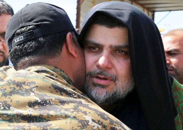 الأحزاب الشيعية في العراق تكسب جولة في صراع البقاء بالسلطة