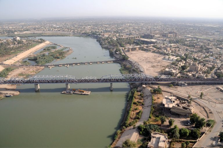 Hundreds of thousands of Shiites make their way across the newly-rebuilt Sarifiyah bridge and a smaller neighboring bridge in their annual pilgrimage to the Kadhamiyah shrine in northern Baghdad, Iraq, July 29, 2008.(Photo by U.S. Army Staff Sgt. Lorie Jewell/Released)