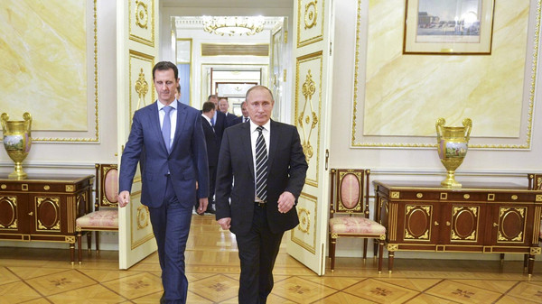 Russian President Vladimir Putin (R) and Syrian President Bashar al-Assad enter a hall during a meeting at the Kremlin in Moscow, Russia, October 20, 2015. Assad made a surprise visit to Moscow on Tuesday evening to thank Putin for launching air strikes against Islamist militants in Syria. Picture taken October 20, 2015. REUTERS/Alexei Druzhinin/RIA Novosti/Kremlin ATTENTION EDITORS - THIS IMAGE HAS BEEN SUPPLIED BY A THIRD PARTY. IT IS DISTRIBUTED, EXACTLY AS RECEIVED BY REUTERS, AS A SERVICE TO CLIENTS.