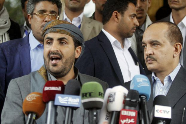Mohammed Abdul-Salam (L), head of the Houthi delegation to scheduled peace talks in Kuwait, speaks at a news conference at Sanaa Airport, Yemen, April 20, 2016. REUTERS/Mohamed al-Sayaghi