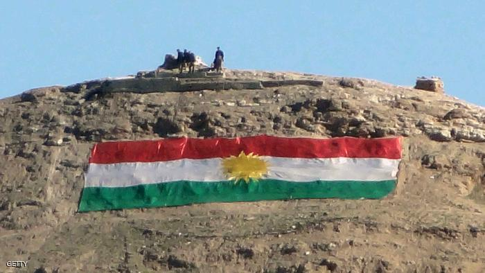 To GO WITH AFP STORY BY WILLIAM DUNLOP A large Kurdish flag appears on a mountain in the town of Tuz Khurmatu, in northern Iraq's Kirkuk province on December 27, 2012. Tuz Khurmatu is a town of mixed identities, a fact emphasised by its flags -- massive Kurdish flags are emblazoned on hills to its east, Iraqi federal flags fly over official buildings and police checkpoints, and countless banners marking the death of a revered Shiite imam flutter from houses. AFP PHOTO / MARWAN IBRAHIM        (Photo credit should read MARWAN IBRAHIM/AFP/Getty Images)