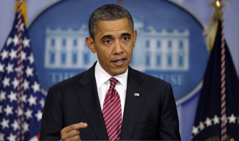 President Barack Obama announces the revamp of his contraception policy requiring religious institutions to fully pay for birth control, during a statement, Friday, Feb. 10, 2012, in the Brady Press Briefing Room of the White House in Washington. (AP Photo/Susan Walsh)
