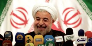 xSourire-nouveau-pr-sident-iranien-Hassan-Rohani-en-juin-2013.jpg.pagespeed.ic.9qkP5aYPHK