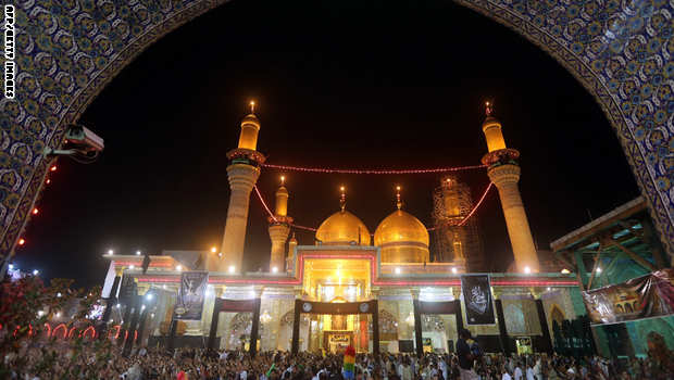 Shiite Muslim pilgrims gather at the shrine of Imam Mussa al-Kadhim, to mark the anniversary of the death of the religious figure on May 24, 2014 in the northern district of Kadhimiya in the Iraqi capital Baghdad. Pilgrims are converging on the Imam's shrine to mark the death of the seventh Imam, who was imprisoned for four years and then poisoned by the then ruler Harun al-Rashid in 795. AFP PHOTO/AHMAD AL-RUBAYE        (Photo credit should read AHMAD AL-RUBAYE/AFP/Getty Images)