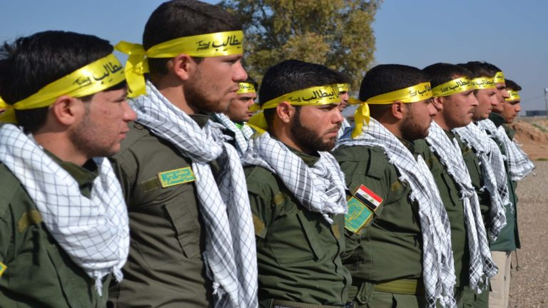 Fighters from the Iraqi Imam Ali Brigade, belonging to the Badr Organisation headed by former Iraqi Transport Minister Hadi al-Amiri, take part in a graduation ceremony in Taza Khurmatu, 20 kms south of Kirkuk, on February 26, 2015. AFP PHOTO / MARWAN IBRAHIM (Photo credit should read MARWAN IBRAHIM/AFP/Getty Images)