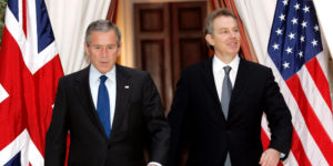 U.S. President George W. Bush (L) and British Prime Minister Tony Blair walk together from their meeting at the U.S. Embassy in Brussels, February 22, 2005. REUTERS/Kevin Lamarque/File Photo