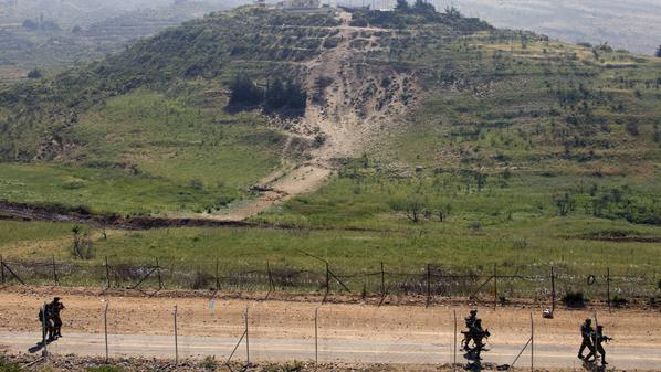 Israeli soliders patrol along the ceasefire line between the Israeli-occupied Golan Heights and Syria, as seen from the Druze village of Majdal Shams, on June 6, 2011, the day after Syrian protesters trying to breech a ceasefire line along the Israeli occupied Golan Heights were shot at, with Damascus saying 23 demonstrators were killed.  AFP PHOTO/JACK GUEZ (Photo credit should read JACK GUEZ/AFP/Getty Images)