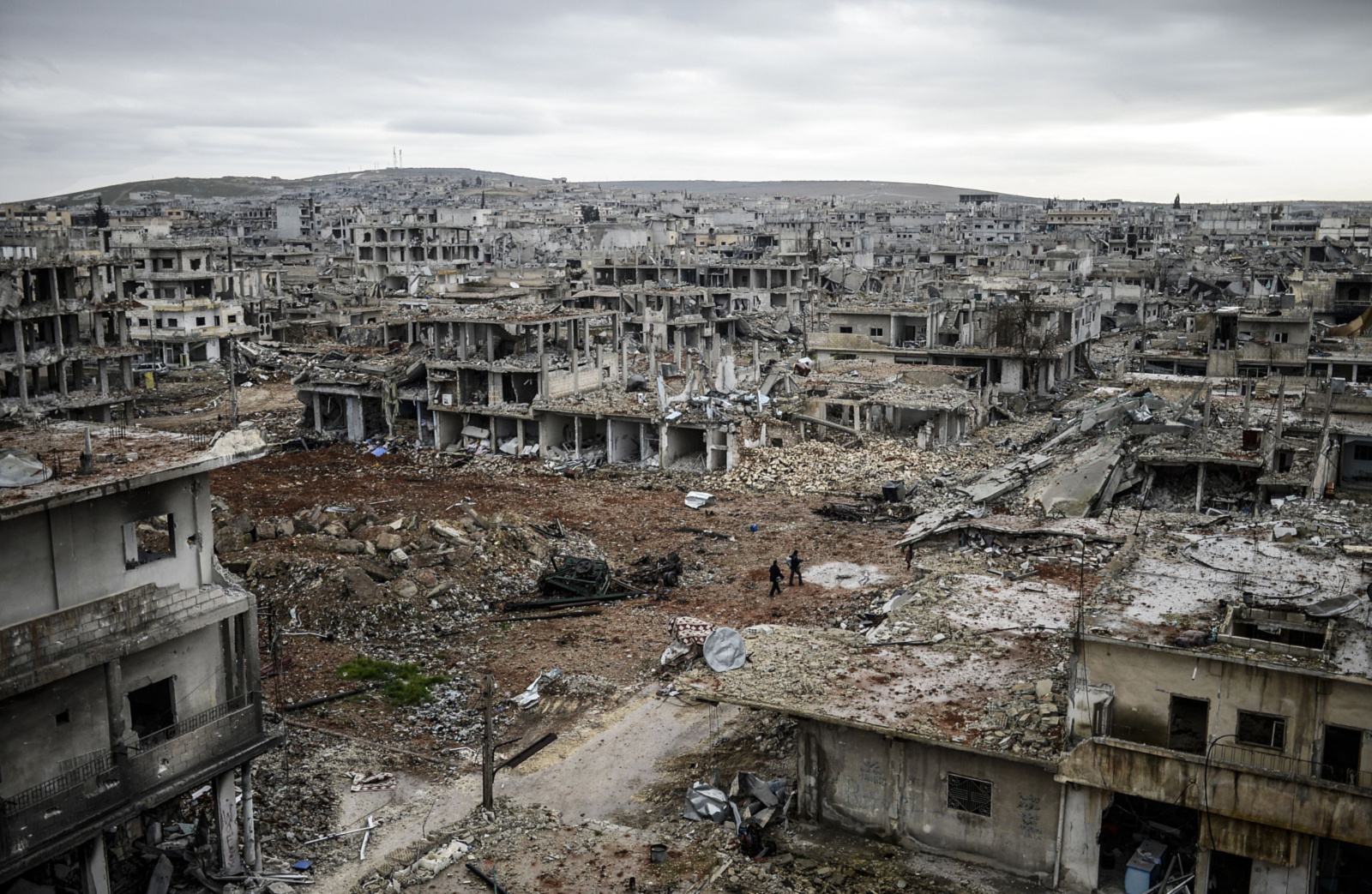 A photo taken on January 30, 2015 shows the eastern part of the destroyed Syrian town of Kobane, also known as Ain al-Arab. Kurdish forces recaptured the town on the Turkish frontier on January 26, in a symbolic blow to the jihadists who have seized large swathes of territory in their onslaught across Syria and Iraq.     AFP PHOTO/BULENT KILICBULENT KILIC/AFP/Getty Images           NYTCREDIT: Bulent Kilic/Agence France-Presse -- Getty Images