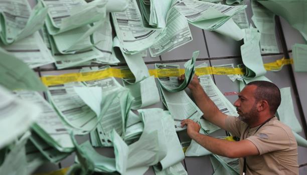 قانون الانتخابات العراقي الجديد… التصويت تحت تهديد السلاح