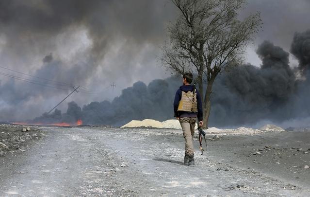iraq-mosul-isis-oil-burning-rtx2rch5-639x405