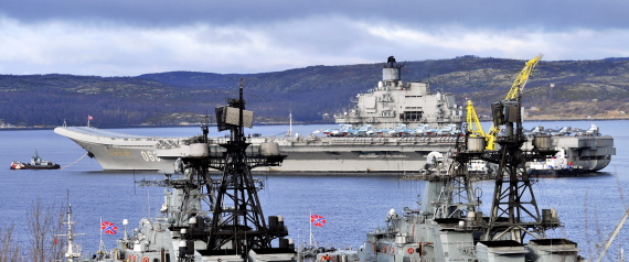 MURMANSK, RUSSIA - OCTOBER 14, 2016: The Russian aircraft carrier Admiral Kuznetsov (background) at a ship-repairing yard ahead of tests of a new air group. Russia's Defense Minister Sergei Shoigu said that the carrier would join Russia's naval group operating in the eastern Mediterranean. Lev Fedoseyev/TASS (Photo by Lev FedoseyevTASS via Getty Images)