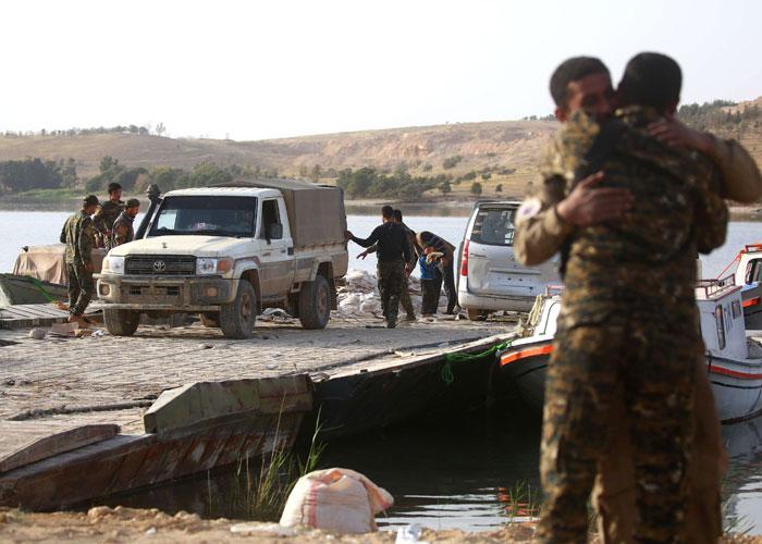الأكراد يتقدمون في الرقة بعد ضمانات أميركية