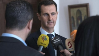 الأسد: الوضع الإنساني في الغوطة «كذبة سخيفة».. وسنستمر في الهجوم