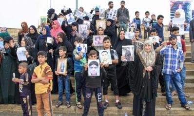 عراقيات في الموصل يؤجلن فرحة العيد انتظارا لعودة ذويهم المفقودين