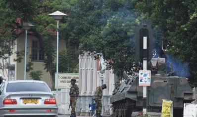 Zimbabwe army has Mugabe, wife in custody, controls capital