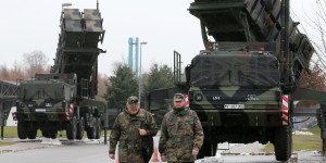 "Soldiers of the Air Defence Missile Squadron 2 walk past Patriot missile launchers in the background in Bad Suelze, northern Germany  on December 4, 2012. Russian President Vladimir Putin warned that any deployment of US-made Patriot missiles on Turkey's volatile border with war-ravaged Syria would exacerbate tensions, and said the two countries had failed to overcome their sharp differences on the conflict. ""Creating additional capabilities on the border does not defuse the situation but on the contrary exacerbates it,"" Putin told a press conference with Turkish Prime Minister Recep Tayyip Erdogan after talks in Istanbul.  AFP PHOTO / BERND WUSTNECK   GERMANY OUT        (Photo credit should read BERND WUSTNECK/AFP/Getty Images)"