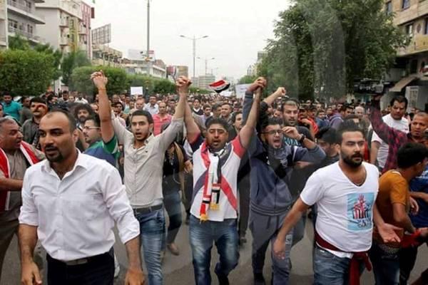 محتجو العراق يتوحدون والبرلمان للتحقيق مع مهاجميهم