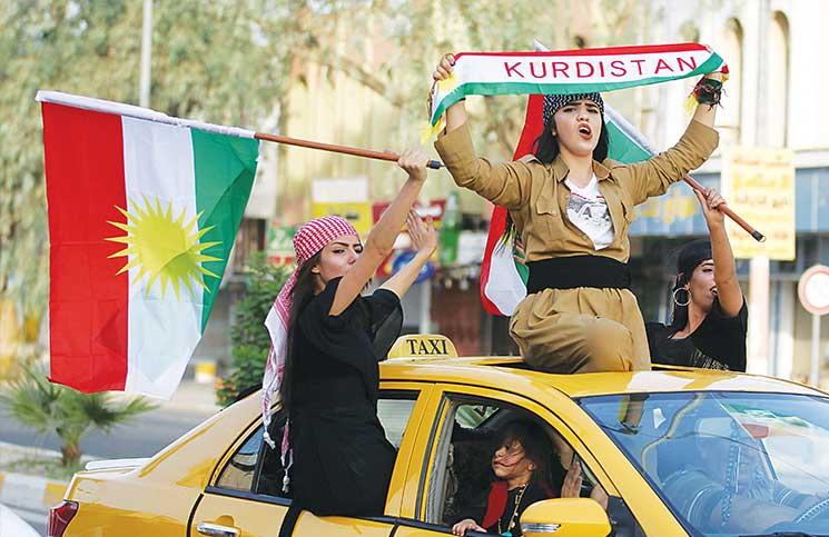 أكراد العراق يصوّتون بكثافة في استفتاء الاستقلال وأنقرة وبغداد تهددان