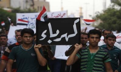 """العبادي """"يسحب يد"""" وزير الكهرباء لامتصاص نقمة الاحتجاجات"""