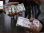 واشنطن تحذر البنوك العراقية من التعاملات النقدية مع المصارف الإيرانية