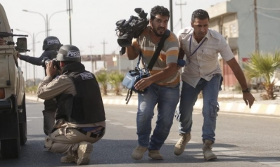 الصحافيون العراقيون يهربون من منازلهم حفاظا على حياتهم ودعوات لتدخل دولي لحمايتهم