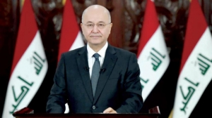 Iraqi President pledges to hold early elections with a new law - and Abdul Mahdi stepped down conditionally