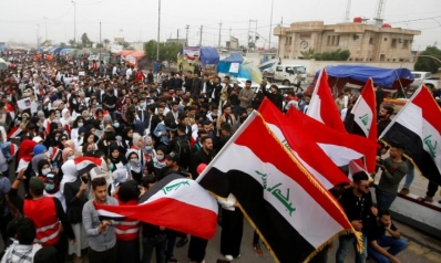 احتجاجات العراق.. مساعٍ للتهدئة في النجف وتحركات لاختيار رئيس الوزراء