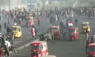 سقوط صواريخ قرب السفارة الأميركية ببغداد.. قتلى وجرحى في مظاهرات غاضبة بالعراق