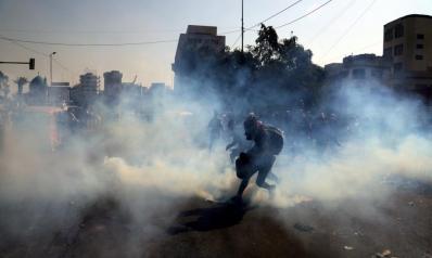 الأمن العراقي يفرق محتجين.. ومتظاهرو النجف يتوعدون بالتصعيد
