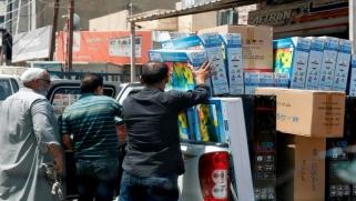 كورونا يهدد تجارة العراق وإيران… وبغداد تؤكد استمرار المعاملات