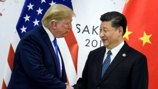 لهجة تصالحية بين واشنطن وبكين لمواجهة وباء كورونا