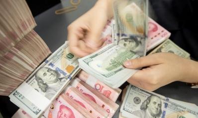 هل ينافس اليوان الصيني الدولار الأميركي على عرش العملات؟