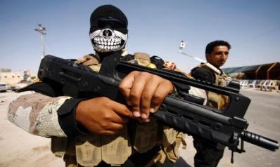 تجدد دعوات إخراج الفصائل المسلحة من المدن العراقية المحررة