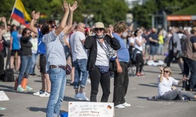 """آلاف الألمان يحتجون ضد """"كذبة"""" كورونا.. انتخابات تاريخية في بوروندي وإيطاليا ترحب مجددا بالزوار"""