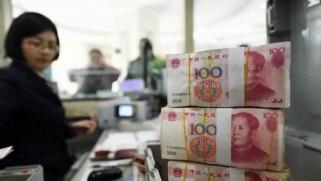 الصين تخفض اليوان إلى أدنى مستوى في 12 عاما
