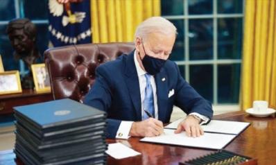 ماذا فعل بايدن في أول 100 يوم له في البيت الأبيض؟